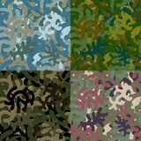 Set of four seamless camouflage patterns Stock Images