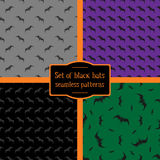 Set of four seamless patterns of black bats Royalty Free Stock Photo