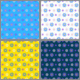 Set of four seamless patterns. With blue and lilac and white little cornflowers on the background of a different color. Summer vector illustration. Suitable for Royalty Free Stock Photography