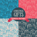 Set of four seamless patterns with christmas gifts. Vector illustration Royalty Free Stock Photo