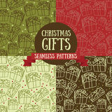 Set of four seamless patterns with christmas gifts. Vector illustration Stock Images