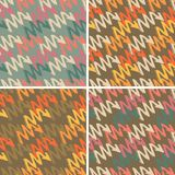 Set with four seamless patterns with colorful grungy arrows. Perfect for print on wrapping paper, fabric etc. Set with four seamless patterns with colorful Stock Image