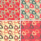 Set with four seamless patterns with colorful grungy arrows. Perfect for print on wrapping paper, fabric etc. Set with four seamless patterns with colorful Royalty Free Stock Photo