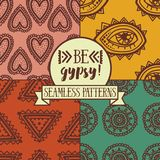 Set of four seamless patterns with ethnic or psychedelic symbols royalty free illustration