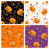 Set of four seamless patterns with Halloween candies. Vector illustration. Vector set of four colorful seamless patterns with Halloween candies Royalty Free Stock Photo