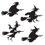 Set of four silhouettes of flying witches Stock Photography