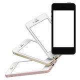Set of four smartphones gold, rose, silver and black with blank screen. Royalty Free Stock Images