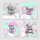 Set of four square posters hand lettering positive quote. On abstract background - believe in magic, dreams come true, once upon a time and live your dreams Royalty Free Stock Photos