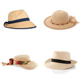 Set of four straw hats Stock Image