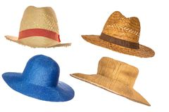 Set of four straw hats isolated on white background royalty free stock photo