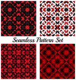 Set of four stylish geometric seamless patterns with different shapes of red, black, grey and white shades Stock Photos
