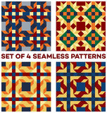 Set of four stylish geometric seamless patterns with rhombus, triangles and squares of blue, green, golden, orange, beige and red Royalty Free Stock Image