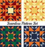 Set of four stylish geometric seamless patterns with triangles and squares of different colors Stock Images