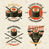Sushi colored vector emblems. Set of four sushi colored vector emblems, labels, badges or logos in vintage style on background with texture royalty free illustration