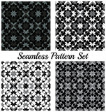 Set of four trendy geometric seamless patterns with rhombus, square, triangle and star shapes of black, grey and white shades Stock Images