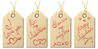 Set of four Valentine`s Day gift tags with handwritten greetings Royalty Free Stock Images