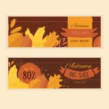 Set of flat autumn leaves banners with grunge labels on wooden background. Set of four vector banners with red, orange, brown and yellow autumn leaves stock illustration