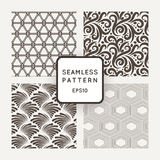 Set of four vector seamless patterns with plants and geometric figures Stock Photography