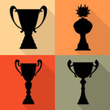 Set of four vector trophy champion cups in flat style. Championship prizes for first place. Royalty Free Stock Photos