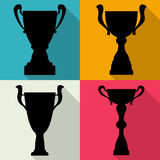 Set of four vector trophy champion cups in flat style. Championship prizes for first place. Victory symbols Stock Photos