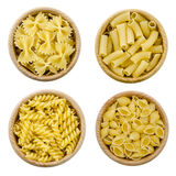 Set of four views, different shapes of pasta in wooden pots. Royalty Free Stock Photography