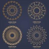 Set of four vintage geometric circular elements. Vector gold monogram on dark blue background. Vector illustration Royalty Free Stock Photography
