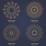 Set of four vintage geometric circular elements. Vector gold monogram on dark blue background. Vector illustration Stock Photo