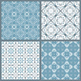 Set of four vintage symmetric seamless patterns stock illustration
