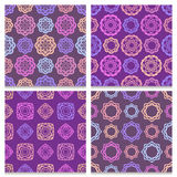 Set of four violet and brown seamless patterns  Stock Photo