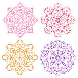 Set of four warm color lacy mandalas Stock Photography
