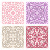 Set of four warm color lacy seamless eastern patterns Stock Photos