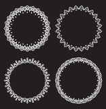 Set of four white round frames on a black background. Royalty Free Stock Photography