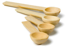 Set of four wooden decorative spoons Royalty Free Stock Photo