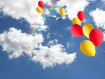 yellow and red balloons with rainbow Royalty Free Stock Photography