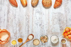 Set of fresh bread and ingredients frame on a wooden table Stock Images