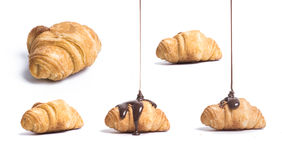 Set of fresh croissant with hot chocolate. On a white background Stock Photography