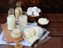 Set of fresh dairy products on wooden background: milk cheese cottage yogurt egg mozzarella ryazhenka feta. Set of fresh dairy products on wooden background Royalty Free Stock Images