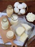 Set of fresh dairy products on wooden background: milk cheese, cottage, yogurt egg mozzarella ryazhenka feta. Stock Photo