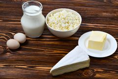 Set of fresh dairy products on wooden background. royalty free stock photos