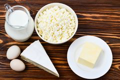 Set of fresh dairy products on wooden background. stock photos