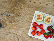 A set of fresh fruit on a wooden desk Stock Photo