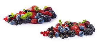 Set of fresh fruits and berries isolated a white background. Ripe blueberries, blackberries, currants, raspberries and strawberrie royalty free stock photo