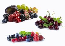 Set of fresh fruits and berries. Ripe blueberries, blackberries, red currants, grapes, raspberries and plums. Various fresh summer. Berries on white background Stock Photo