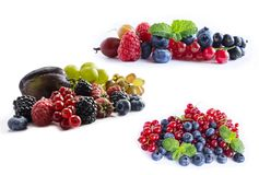 Set of fresh fruits and berries. Ripe blueberries, blackberries, red currants, grapes, raspberries and plums. Various fresh summer. Berries on white background Royalty Free Stock Image