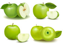 Set of fresh green apples with green leafs. Royalty Free Stock Photos