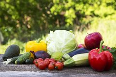 Set of fresh organic fruits and vegetables on wooden table. Side stock photography