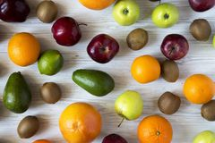 Set of fresh raw fruits on white wooden background. Top view. Flat lay. Summer background Stock Photography