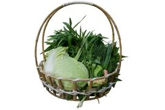 Set of fresh, raw green vegetables in a wooden basket. Isolated on white background Royalty Free Stock Image