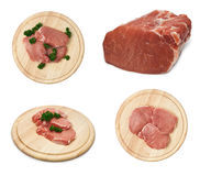 Set of fresh raw pork steak meat on wooden cutting Stock Images