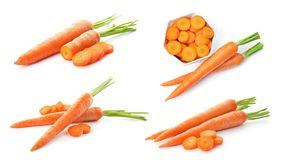 Set with fresh ripe carrots. On white background royalty free stock images